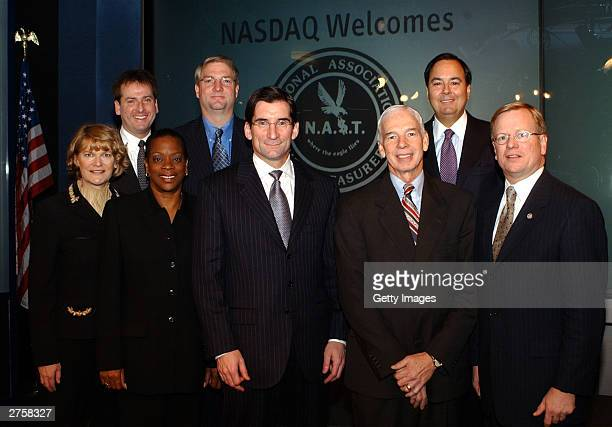 Nasdaq officials and State Treasurers pose before going to a meeting to discuss corporate governance at the NASDAQ MarketSite Times Square on...