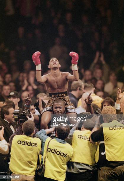Naseem Hamed celebrates defeating Tom Johnson of the United States to retain his World Boxing Organization featherweight title and winning the...