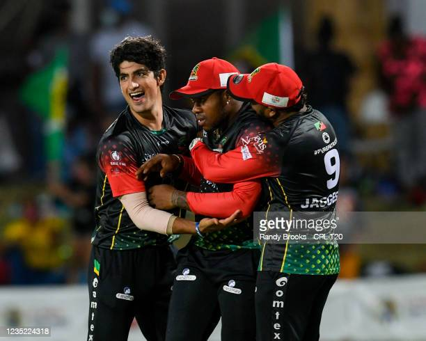 Naseem Shah , Fabian Allen and Jon Russ Jaggesar of Saint Kitts & Nevis Patriots celebrate the dismissal of Lendl Simmons of Trinbago Knight Riders...