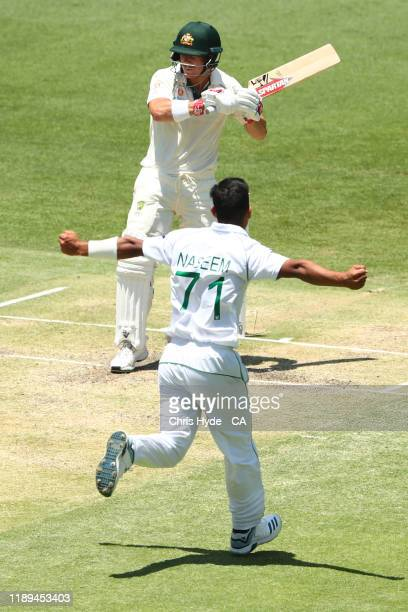 Naseem Shah of Pakistan celebrates after taking his first test wicket the wicket of David Warner of Australia during day three of the 1st Domain Test...