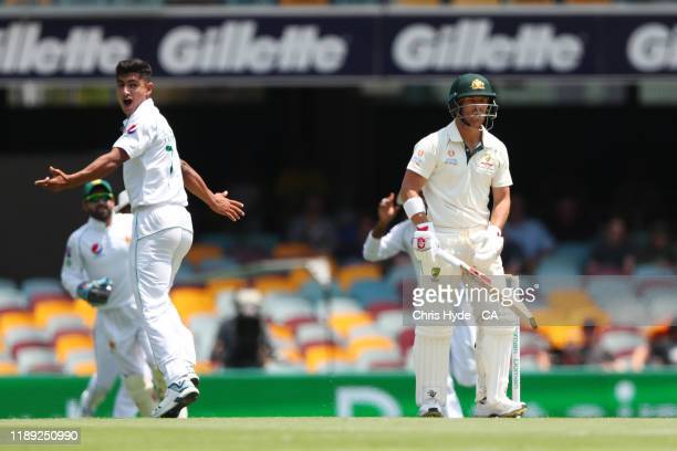 Naseem Shah of Pakistan celebrates dismissing David Warner of Australia before the decison is overturned during day two of the 1st Domain Test...