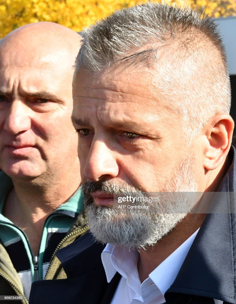 Naser Oric, wartime commander of Bosnian Muslim forces in the area of Srebrenica and Bratunac, leaves court in Sarajevo on October 9, 2017. A Sarajevo court acquitted Naser Oric, a commander revered by many as the defender of Muslims during Bosnia's 1990s conflict but viewed as a butcher by Serbs, of war crimes charges. Oric, 50, was bodyguard to former Yugoslav president Slobodan Milosevic and is one of only a few Bosnian Muslim commanders to have faced trial for atrocities committed against Serbs. BARUKCIC