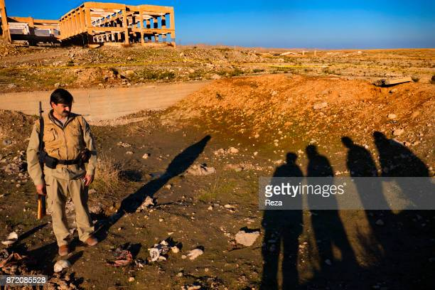 Naser Pasha Khalaf Director of Public Relations and Culture of the KDP in Sinjar and its surrounding area stands in front of one of the former fish...