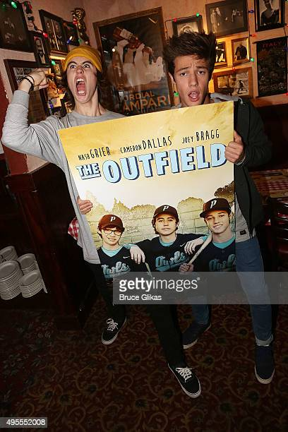 Nash Grier and Cameron Dallas promote the iTunes film 'The Outfield' at Buca di Beppo Times Square on November 3 2015 in New York City