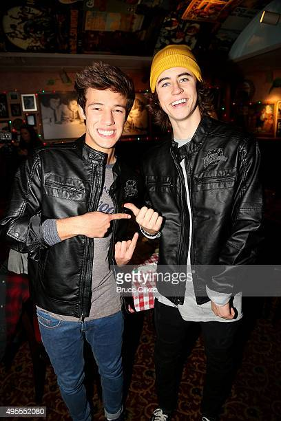 Nash Grier and Cameron Dallas promote the iTunes film 'The Outfield' at Planet Hollywood Times Square on November 3 2015 in New York City