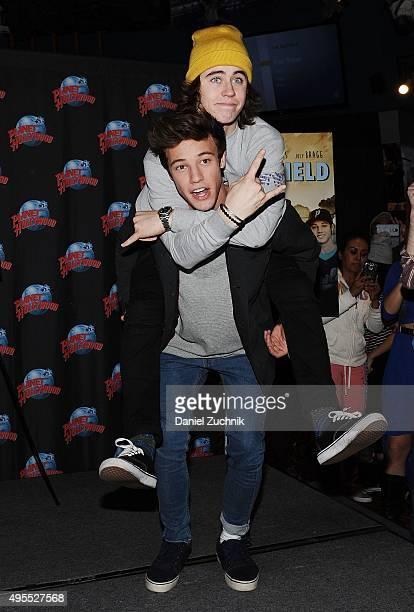 Nash Grier and Cameron Dallas visit Planet Hollywood Times Square to promote their film 'The Outfield' on November 3 2015 in New York City