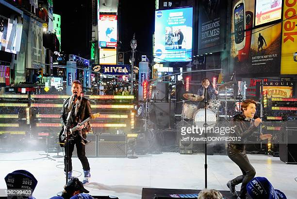 Nash Overstreet and Ryan Follese of Hot Chelle Rae perform during Dick Clark's New Year's Rockin' Eve with Ryan Seacrest 2012 at Times Square on...