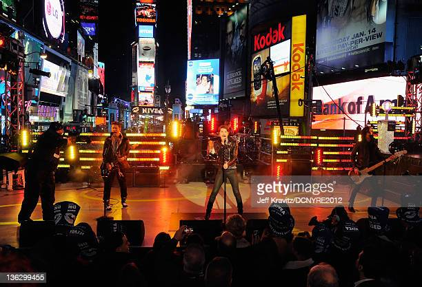 Nash Overstreet Ryan Follese Jamie Follese and Ian Keaggy of Hot Chelle Rae perform during Dick Clark's New Year's Rockin' Eve with Ryan Seacrest...