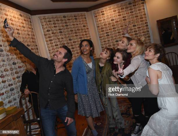Nashville cast members do a selfie with Charles Esten Rhiannon Giddens Odessa Adlon Maisy Stella Lennon Stella Hayden Panettier and Clare Bowen...