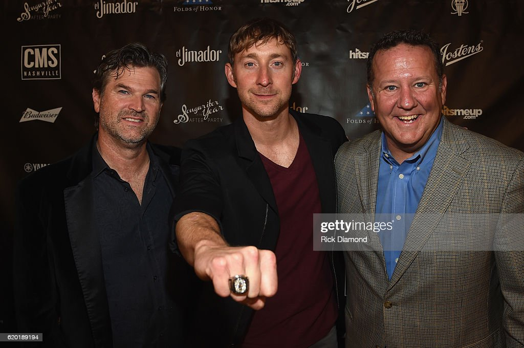 Nashville Chairman and CEO Chris King, Songwriter of the Year honoree Ashley Gorley and Jostens VP, Curt Bruns attend the Folds of Honor/CMS Nashville Songwriter of the Year Party during the 50th annual CMA Awards week on November 1, 2016 in Nashville, Tennessee.