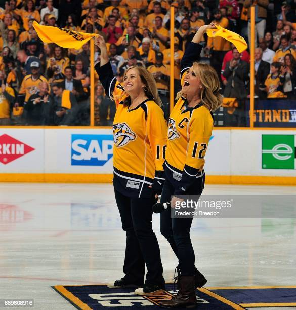 Nashville Mayor Megan Barry and singer Carrie Underwood wave rally towels prior to Game Three of the Western Conference First Round between the...