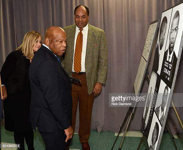 Nashville Mayor Megan Berry Congressman/Civil Rights Icon John Lewis and Attorney David Ewing standing by images and arrest record of John Lewis for...
