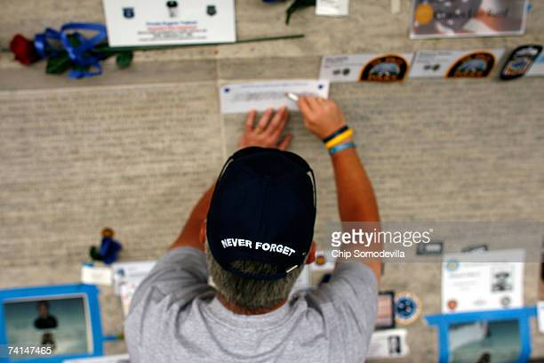 Nashville Metro Police Detective Jere B Clark makes a rubbing of a name carved into the wall at the National Law Enforcement Officers Memorial during...
