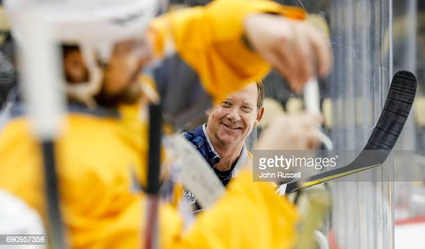 Nashville Predators assistant coach Phil Housley smiles as he talks to players before practice prior to Game Two of the 2017 NHL Stanley Cup Final at...