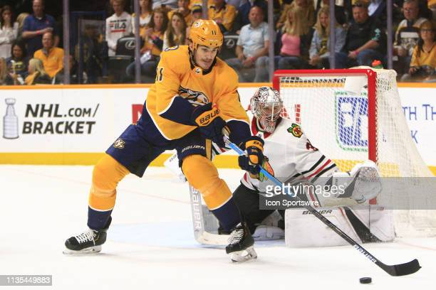 Nashville Predators center Brian Boyle receives a pass in front of Chicago Blackhawks goalie Cam Ward during the NHL game between the Nashville...