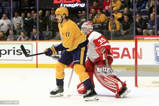 Nashville Predators center Brian Boyle shields Detroit Red Wings goalie Jimmy Howard during the NHL game between the Nashville Predators and Detroit...