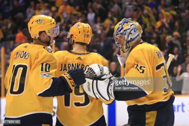 Nashville Predators center Colton Sissons congratulates Nashville Predators goalie Pekka Rinne at the conclusion of the NHL game between the...