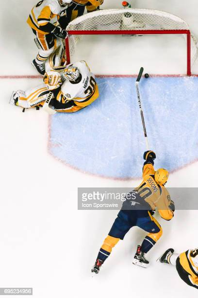 Nashville Predators center Colton Sissons reaches to tap in puck for apparent goal during game 6 of the 2017 NHL Stanley Cup Finals between the...