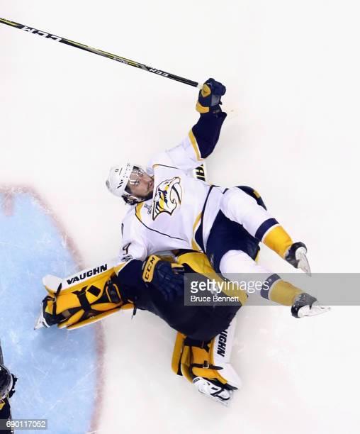 Nashville Predators center Filip Forsberg flips over Pittsburgh Penguins goalie Matt Murray during Game One of the 2017 NHL Stanley Cup Final at the...