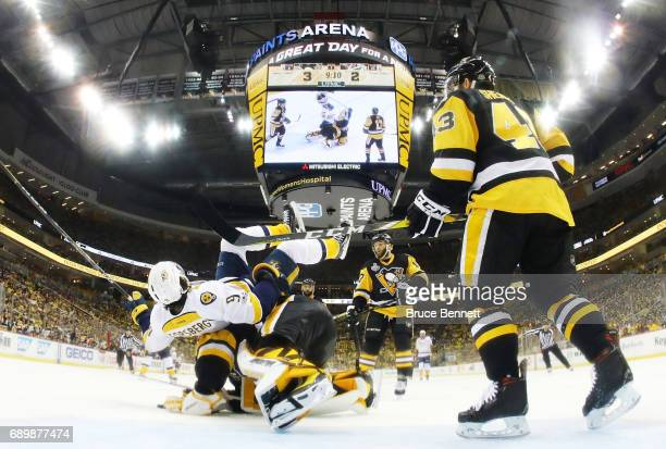 Nashville Predators center Filip Forsberg trips over Pittsburgh Penguins goalie Matt Murray during the third period in Game One of the 2017 NHL...