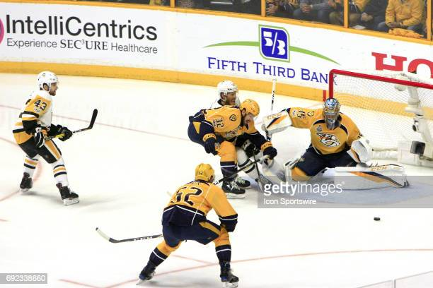 Nashville Predators center Frederick Gaudreau shields Pittsburgh Penguins right wing Carter Rowney from the puck during Game 3 of the Stanley Cup...
