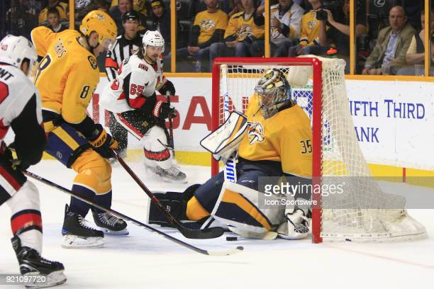 Nashville Predators center Kyle Turris protects the puck from Ottawa Senators right wing Gabriel Dumont as Nashville Predators goalie Pekka Rinne...