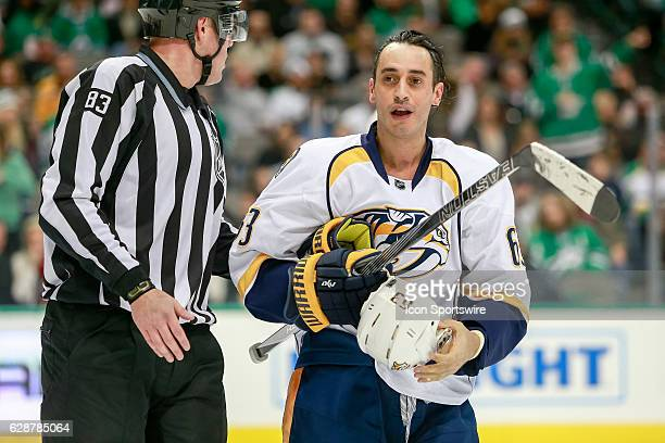 Nashville Predators Center Mike Ribeiro is escorted away from a confrontation during the NHL game between the Nashville Predators and Dallas Stars on...