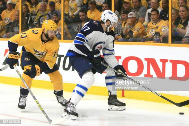 Nashville Predators center Nick Bonino defends against Winnipeg Jets center Adam Lowry during Game Seven of Round Two of the Stanley Cup Playoffs...