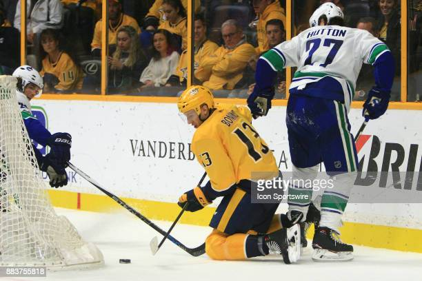 Nashville Predators center Nick Bonino plays the puck from behind the goal during the NHL game between the Nashville Predators and the Vancouver...
