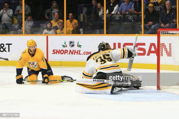 Nashville Predators center Nick Bonino scores a goal on Boston Bruins goalie Anton Khudobin during the NHL game between the Nashville Predators and...