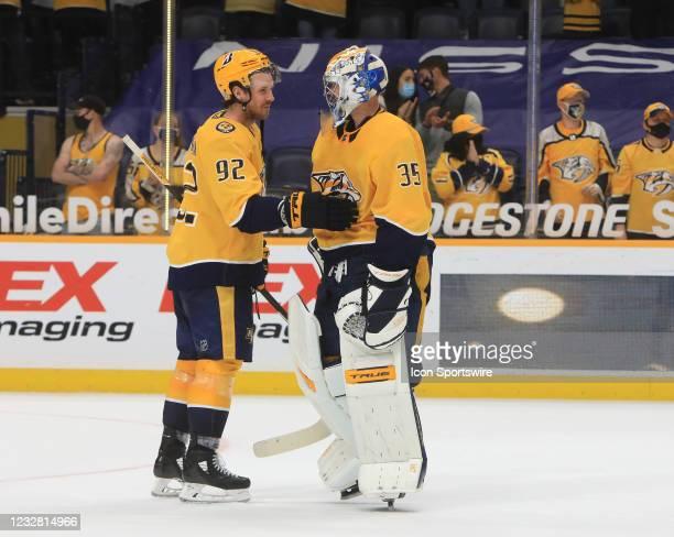 Nashville Predators center Ryan Johansen congratulates goalie Pekka Rinne , of Finland, at the conclusion of the NHL game between the Nashville...