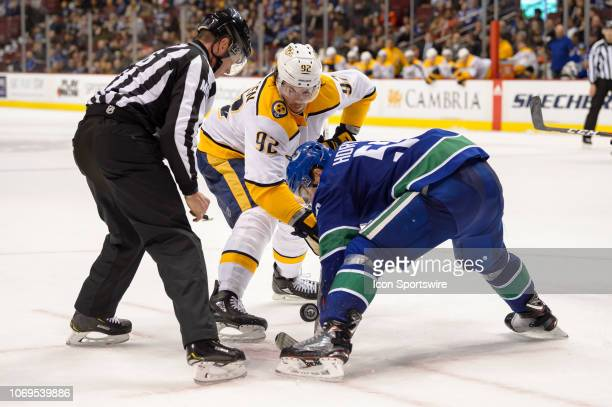 Nashville Predators Center Ryan Johansen faces off against Vancouver Canucks Center Bo Horvat during their NHL game at Rogers Arena on December 6,...