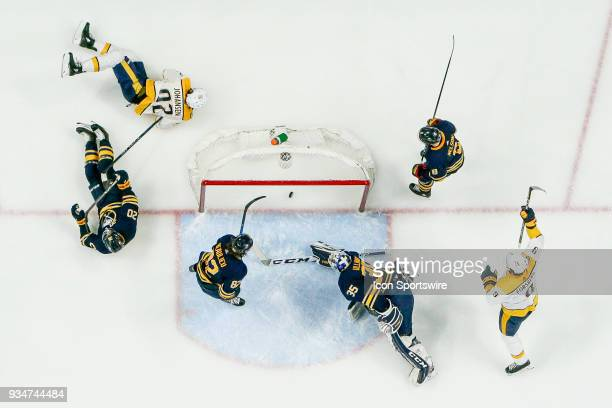 Nashville Predators Center Ryan Johansen falls to ice after scoring goal past Buffalo Sabres Goalie Linus Ullmark during the Nashville Predators and...