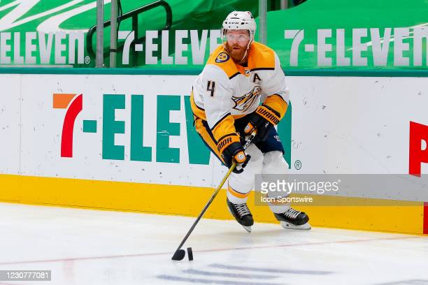 Nashville Predators Defenceman Ryan Ellis handles the puck during the game between the Nashville Predators and Dallas Stars on January 24, 2021 at...