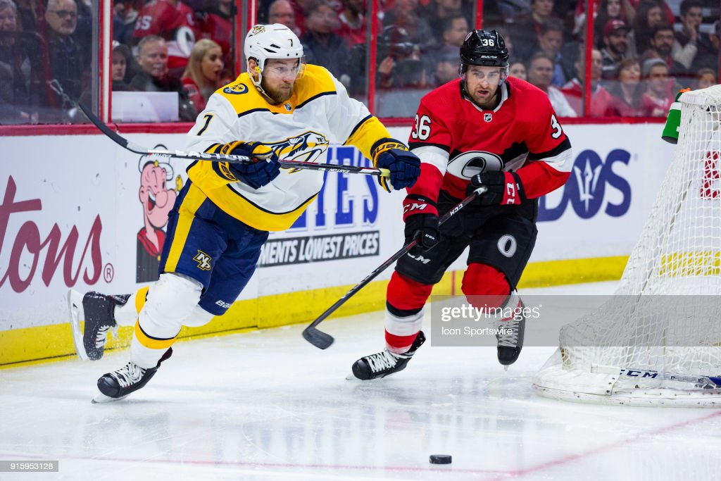 Nashville Predators Defenceman Yannick Weber (7) and Ottawa Senators Right Wing Colin White (36) chase a loose puck during first period National Hockey League action between the Nashville Predators and Ottawa Senators on February 8, 2018, at Canadian Tire Centre in Ottawa, ON, Canada.