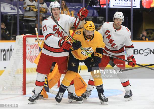 Nashville Predators defenseman Alexandre Carrier and Carolina Hurricanes left wing Andrei Svechnikov are shown during Game 6 of the first round of...