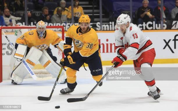 Nashville Predators defenseman Jeremy Davies defends against Carolina Hurricanes left wing Warren Foegele during the NHL game between the Nashville...