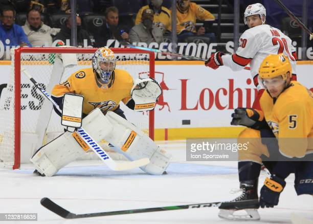 Nashville Predators defenseman Matt Benning attempts to block the shot as Nashville Predators goalie Pekka Rinne , of Finland, and Carolina...