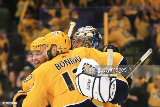 Nashville Predators defenseman Matt Irwin and Nashville Predators center Nick Bonino congratulate Nashville Predators goalie Pekka Rinne at the...