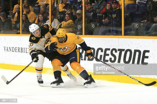 Nashville Predators defenseman PK Subban and Boston Bruins right wing Anders Bjork skate past the puck as they battle for position during the NHL...