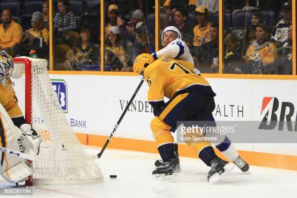 Nashville Predators defenseman PK Subban and Lightning forward Gabriel Dumont battle for the puck during the NHL preseason game between the Nashville...
