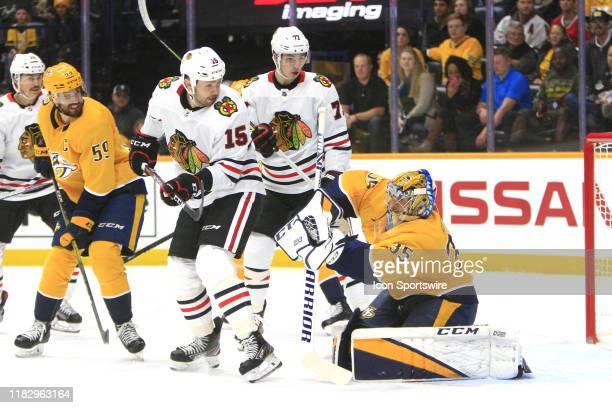 Nashville Predators defenseman Roman Josi Chicago Blackhawks left wing Zack Smith and right wing Kirby Dach look on as goalie Pekka Rinne makes a...