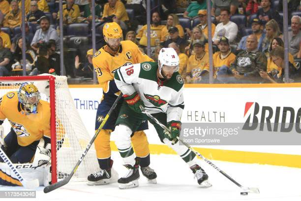 Nashville Predators defenseman Roman Josi defends against Minnesota Wild left wing Jordan Greenway as goalie Pekka Rinne protects the post during the...