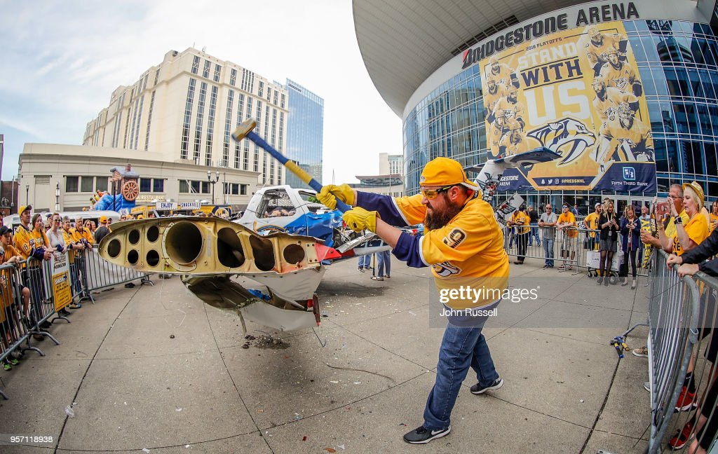 Nashville Predators fan Eric Roberts hammers away on the Winnipeg Smash Jet prior to Game Seven of the Western Conference Second Round against the Winnipeg Jets during the 2018 NHL Stanley Cup Playoffs at Bridgestone Arena on May 10, 2018 in Nashville, Tennessee.