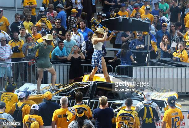 Nashville Predators fan hits a Pittsburgh Penguins car with a sledgehammer prior to Game Three of the 2017 NHL Stanley Cup Final between the...