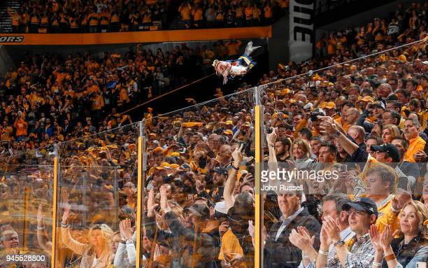 Nashville Predators fan hurls a catfish over the glass prior to Game One of the Western Conference First Round against the Colorado Avalanche during...