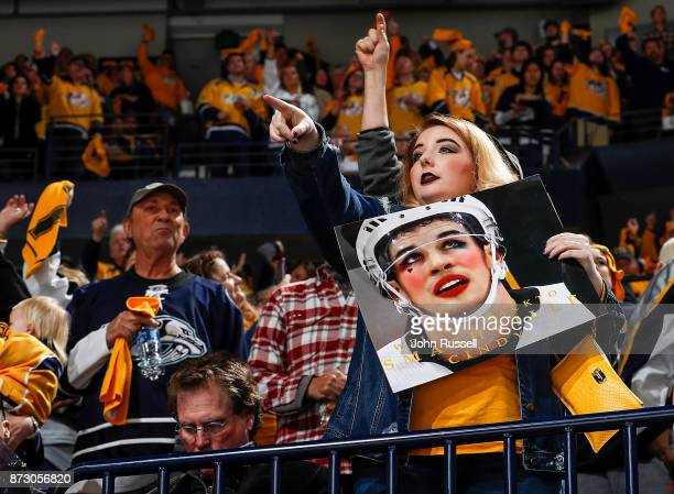 Nashville Predators fan taunts Sidney Crosby of the Pittsburgh Penguins during an NHL game at Bridgestone Arena on November 11 2017 in Nashville...