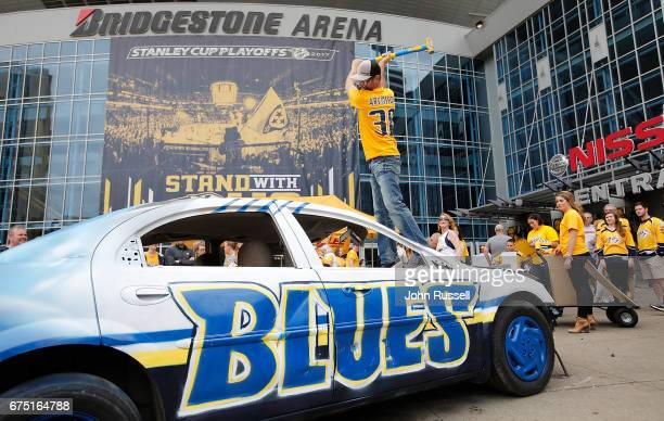 Nashville Predators fan Tim Darling takes a swing at the Smash the Blues car to benefit the Nashville Predators Foundation prior to Game Three of the...