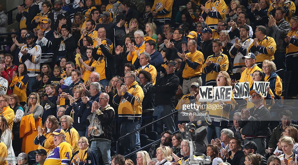 Nashville Predators fans give a standing ovation during a timeout against the Calgary Flames in the third period of an NHL game at Bridgestone Arena on March 29, 2015 in Nashville, Tennessee.