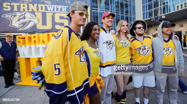 Nashville Predators fans pose for photos prior to Game Six of the Western Conference Second Round against the St Louis Blues during the 2017 NHL...